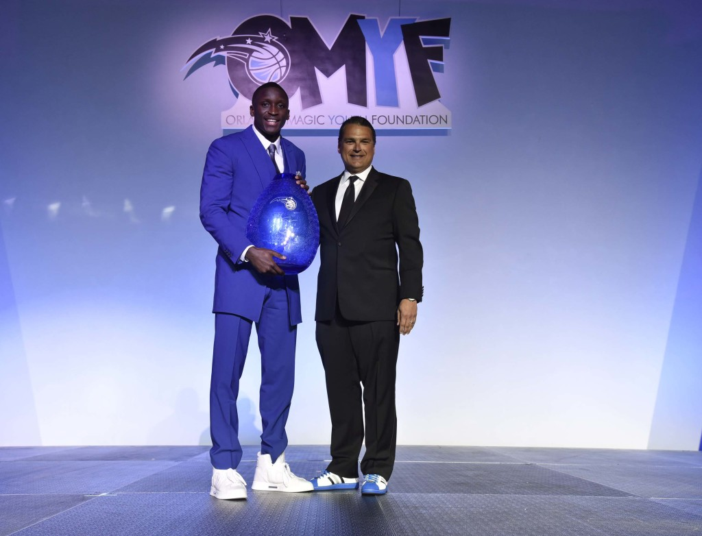For his efforts in the community, Magic guard Victor Oladipo (left) is presented the 2015-16 Rich and Helen DeVos Community Enrichment Award by Magic CEO Alex Martins. Photo taken by Fernando Medina, Orlando Magic.