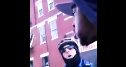 Cop confronts Charles Harell