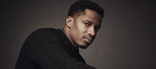 nate parker (wearing sweater - slider)