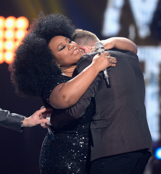 "American Idol Season 15 winner Trent Harmon (R) and finalist La'Porsha Renae hug onstage during FOX's ""American Idol"" Finale For The Farewell Season at Dolby Theatre on April 7, 2016 in Hollywood, California. at Dolby Theatre on April 7, 2016 in Hollywood, California."