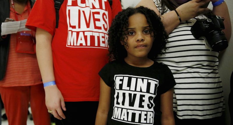 """Mari Copeny, 8, of Flint, Michigan, waits in line to enter a hearing room where Michigan Governor Rick Snyder (R) and EPA Administrator Gina McCarthy will testify before a House Oversight and government Reform hearing on """"Examining Federal Administration of the Safe Drinking Water Act in Flint, Michigan, Part III"""" on Capitol Hill in Washington in this March 17, 2016, file photo."""