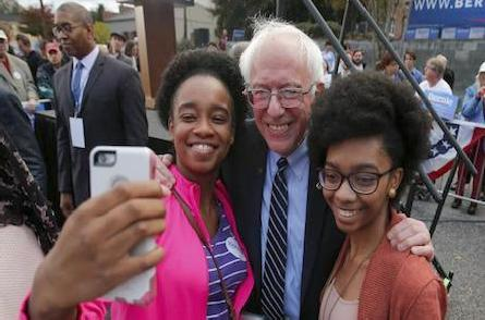 bernie sanders & 2 young black women