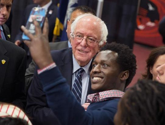 bernie sanders & black man taking selfie