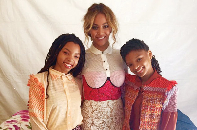 Beyoncé (center) had Chloe (left) and Halle's back at a performance at the White House on March 28.