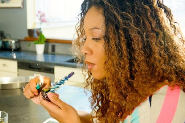 female marijuana user smoking pipe