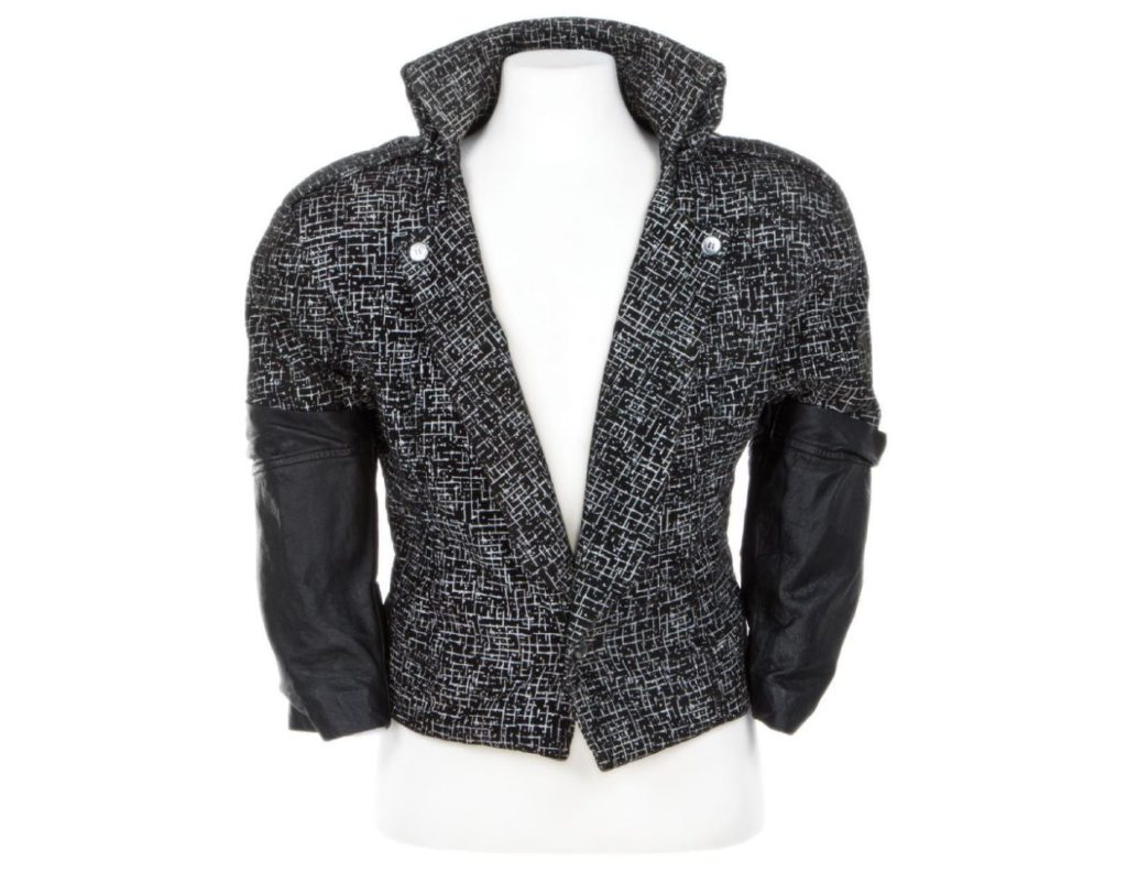 """This image released by Profiles in History shows a black and white blazer with leather sleeves, worn by Prince in the 1984 film, """"Purple Rain."""" The item will be auctioned on June 29, along with costumes worn by Britney Spears, Katy Perry, Alicia Keys and a Swarovski crystal studded glove from Michael Jackson's 1992 Dangerous world tour. (Charlie Nunn/Profiles in History via AP)"""