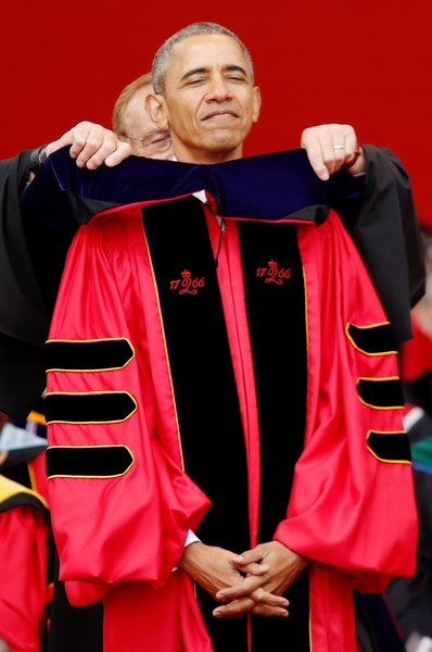 U.S. President Barack Obama receives an honorary doctorate of laws while attending the 250th anniversary commencement ceremony at Rutgers University on May 15, 2016 in New Brunswick, New Jersey.