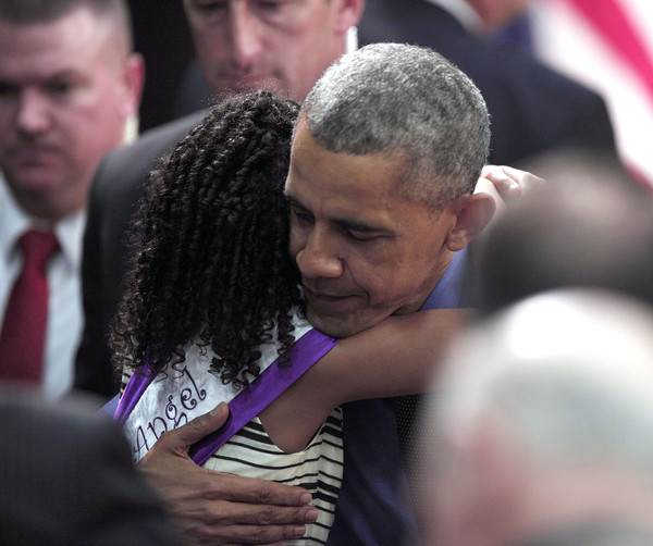 U.S. President Barack Obama hugs Maryanna Copeny of Flint, Michigan, age 8, after speaking at Northwest High School about the Flint water contamination crisis on May 4, 2016 in Flint, Michigan