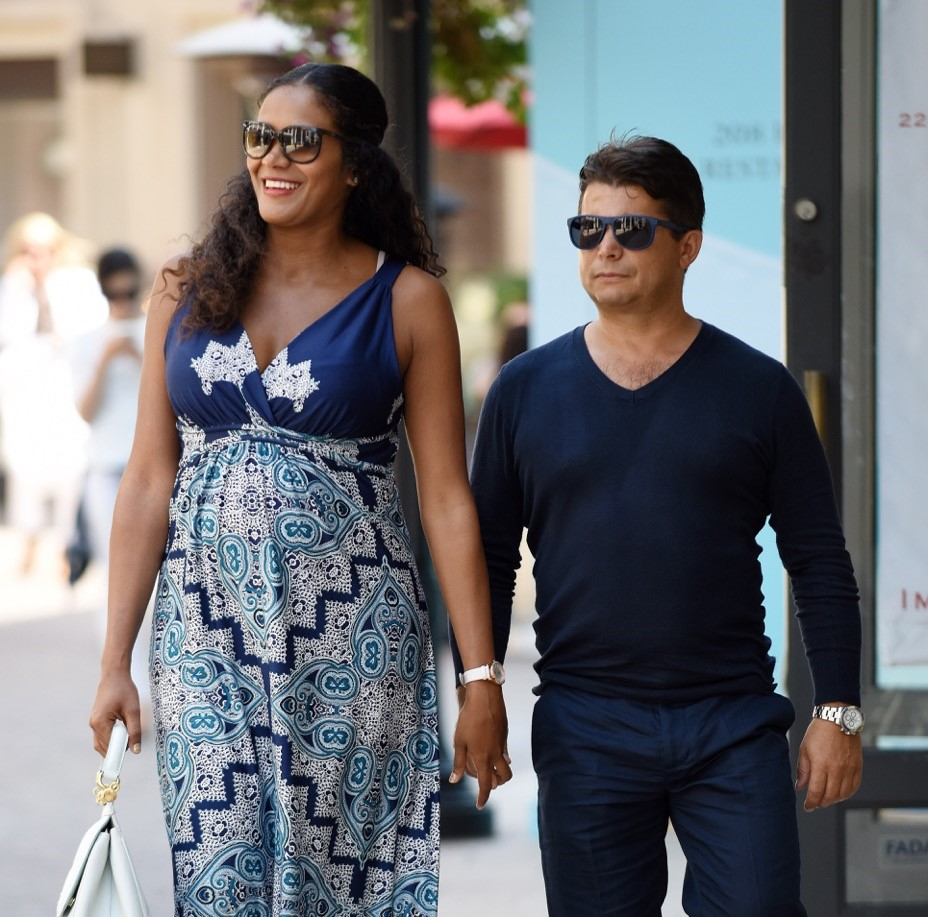 Oscar Generale and Denny Mendez stroll through Beverly Hills sporty with a baby bump.