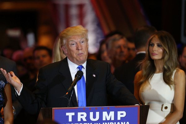 Republican presidential front runner Donald Trump stands near his wife Melania Trump as he speaks to supporters and the media at Trump Tower in Manhattan following his victory in the Indiana primary on May 03, 2016 in New York City.