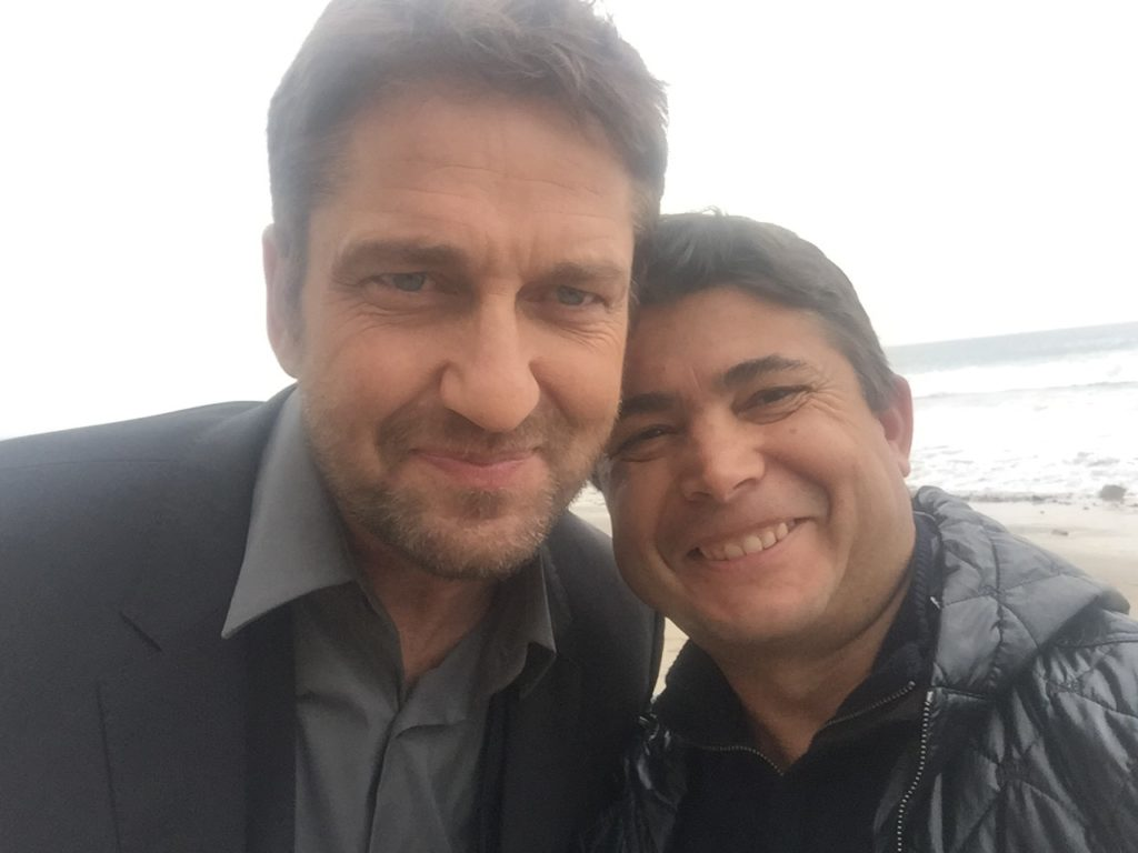 Producer and product placement king Oscar Generale flashes a confident smile with actor Gerard Butler on the set of new Festina commercial.