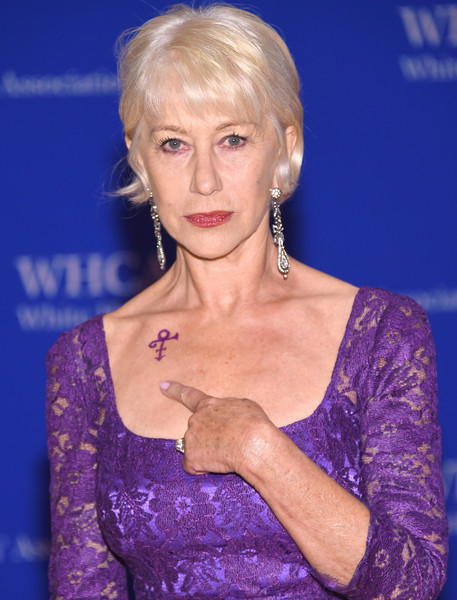 Actress Helen Mirren shows her Prince symbol tribute at the 102nd White House Correspondents' Association Dinner on April 30, 2016 in Washington, DC.
