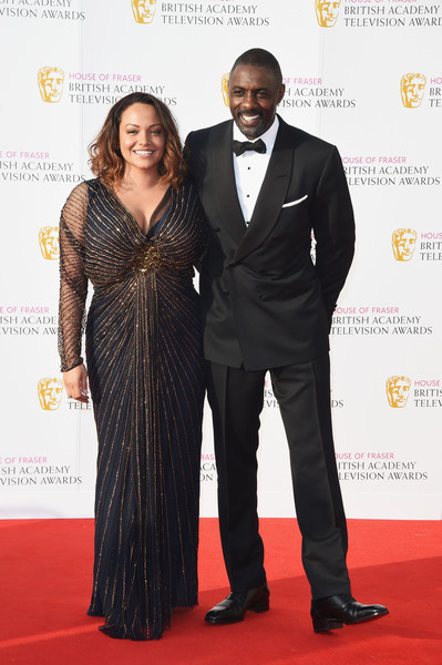 Naiyana Garth and Idris Elba attend the House Of Fraser British Academy Television Awards 2016 at the Royal Festival Hall on May 8, 2016 in London, England.