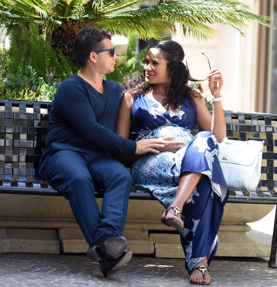Celebrity couple Oscar Generale and Denny Mendez take a break from shopping for baby clothes in Beverly Hills. Their new arrival is expected late summer 2016.