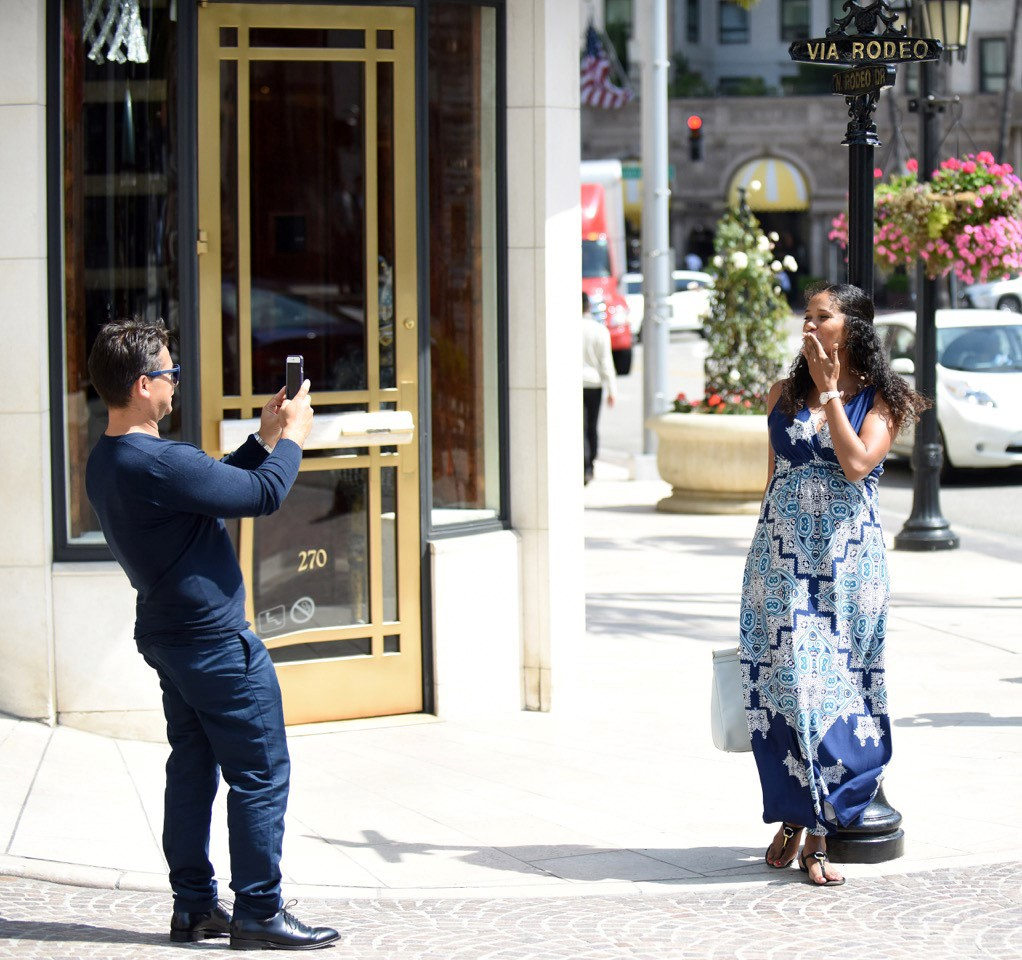 Ritzy Italian superstar Denny Mendez blows a kiss to her fiance' and producer Oscar Generale during shopping spree on Rodeo Drive in Beverly Hills, CA (May 2016)