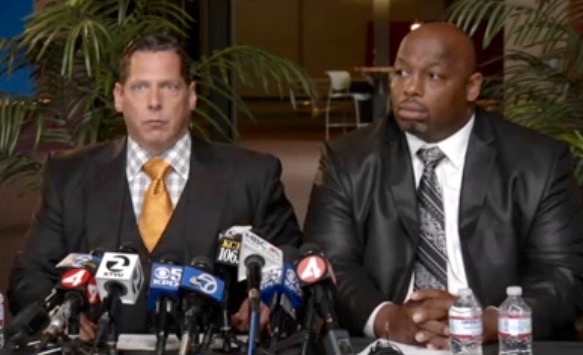 Dana Stubblefield (L) with his lawyer Ken Rosenfeld at a news conference (May 3, 2016)