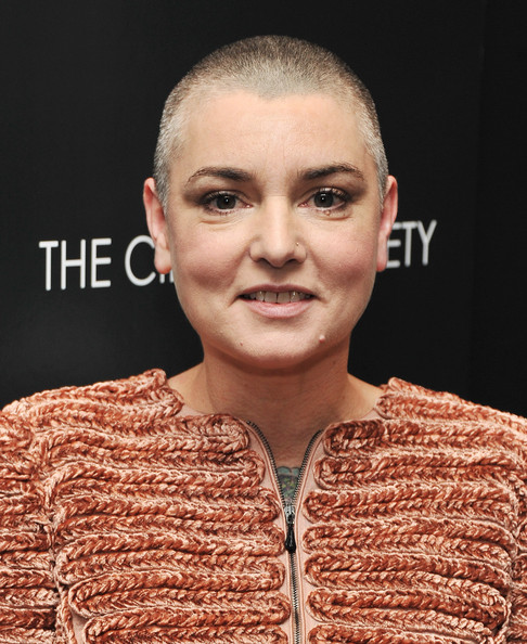 "Singer Sinead O'Connor attends the Giorgio Armani & Cinema Society screening of ""Albert Nobbs"" at the Museum of Modern Art on December 13, 2011 in New York City."
