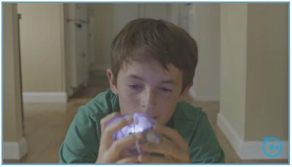boy with clear lighted ball