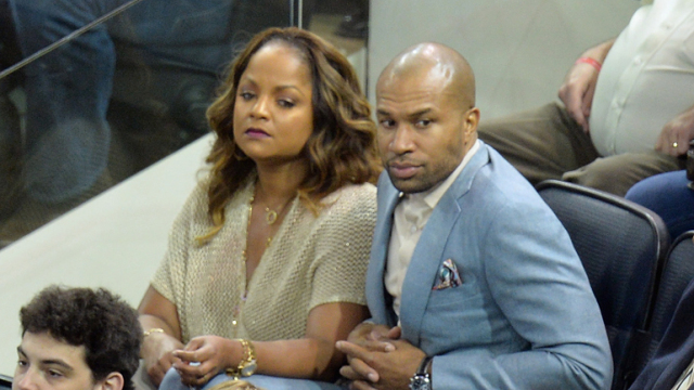 Candace Fisher (L) and New York Knicks head coach Derek Fisher attend Game 4 of the 2014 NHL Stanley Cup Final at Madison Square Garden on June 11, 2014. (Photo by Mike Coppola/Getty Images)