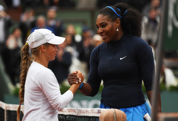 Serena Williams of the United States shakes hands with Yulia Putintseva of Kazakhstan following her victory during the Ladies Singles quarter final match on day twelve of the 2016 French Open at Roland Garros on June 2, 2016 in Paris, France.
