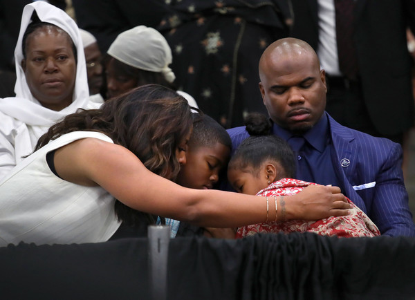 Muhammad Ali's daughter Laila (L), comforts her family during an Islamic prayer service at the Kentucky Exposition Center on June 9, 2016 in Louisville, Kentucky.