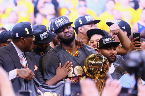 LeBron James #23 of the Cleveland Cavaliers holds the Larry O'Brien Championship Trophy after defeating the Golden State Warriors 93-89 in Game 7 of the 2016 NBA Finals at ORACLE Arena on June 19, 2016 in Oakland, California.