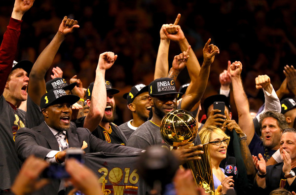 LeBron James #23 of the Cleveland Cavaliers holds the Larry O'Brien Championship Trophy after defeating the Golden State Warriors 93-89 in Game 7 of the 2016 NBA Finals at ORACLE Arena on June 19, 2016 in Oakland, California