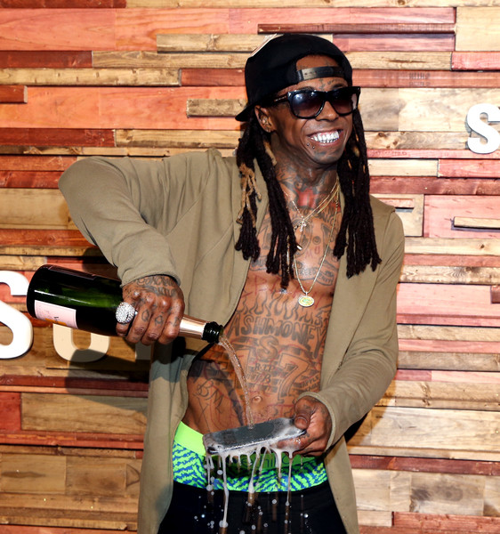Rapper Lil Wayne pours champagne over his Samsung Galaxy S7 at Samsung Galaxy Life Fest at SXSW 2016 on March 12, 2016 in Austin, Texas.