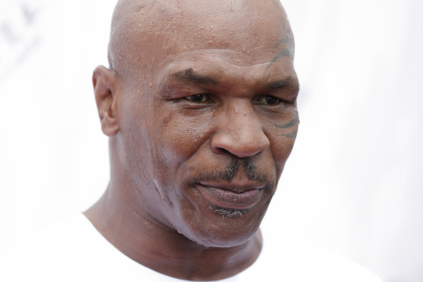 Former Heavy Weight Champion Boxer Mike Tyson attends the Great Wall Weigh-in of IBF World Boxing Championship Bout at Mutianyu on May 24, 2016 in Beijing, China.