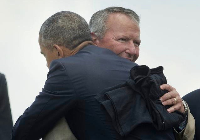 President Barack Obama and Orlando Mayor Buddy Dyer embrace on the tarmac upon Obama's arrival on Air Force One at Orlando International Airport, Thursday, June 16, 2016. Pablo Martinez Monsivais AP