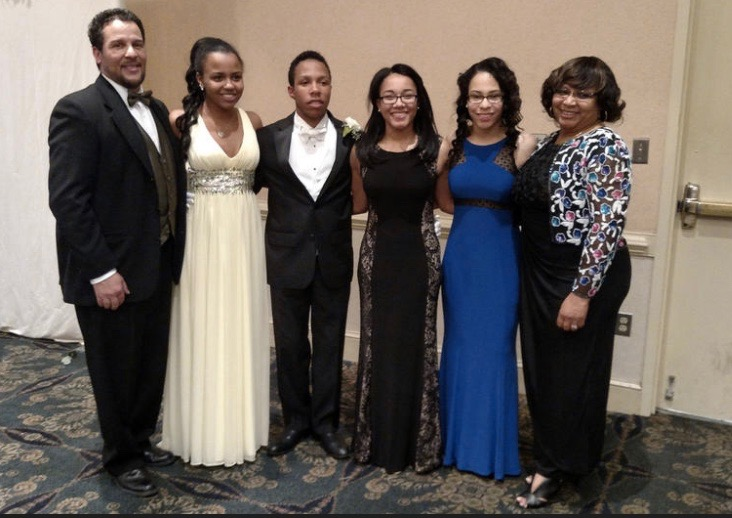 From left to right, Adam, Alexis, Brandon, Christina, Dominique, and Lisa Scott pose for a picture taken at the Alpha Kappa Alpha Sorority Cotillion in Timonium in late May. Brandon was an escort for the event.
