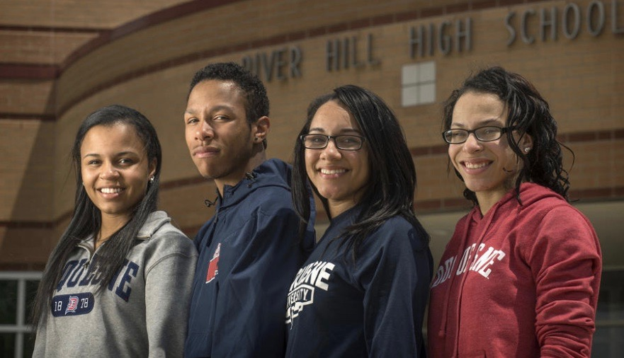 The quadruplet siblings of (L-R) Alexis, Brandon, Christina, and Dominique Scott are among the graduating seniors at River Hill High School. All four are set to attend Duquesne University in the fall. (Doug Kapustin / Baltimore Sun Media Group)
