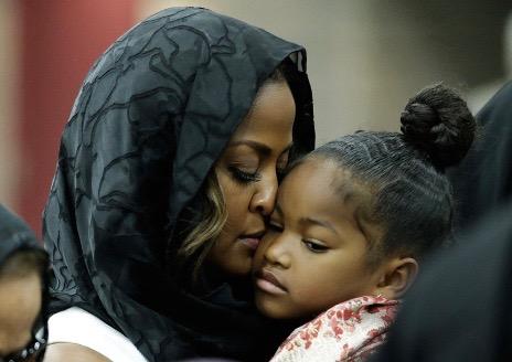 Muhammad Ali's daughter Laila (L), comforts her daughter during an Islamic prayer service at the Kentucky Exposition Center on June 9, 2016 in Louisville, Kentucky.