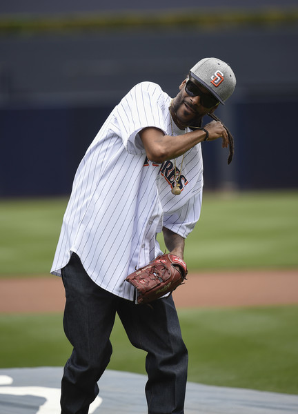Snoop Dogg throws out the ceremonial first pitch before a baseball game between the San Diego Padres and the Atlanta Braves at PETCO Park on June 8, 2016 in San Diego, California.