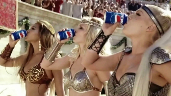 Beyonce, Britney Spears, and Pink drink Pepsi in a Gladiator-themed commercial. Image via YouTube.