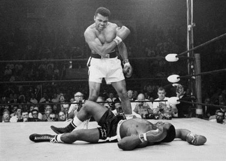 muhammad ali towering over sonny liston (classic pic)