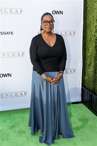 """In this Wednesday, June 15, 2016 file photo, Oprah Winfrey arrives at the season one premiere of """"Greenleaf"""" at The Lot in West Hollywood, Calif. Winfrey reacts to the Orlando mass shooting: """"Are we a country that really believes that assault weapons shouldbe made available to anybody?Are assault weapons necessary?I just say, 'Enough.'""""  (Photo by Willy Sanjuan/Invision/AP, File)"""