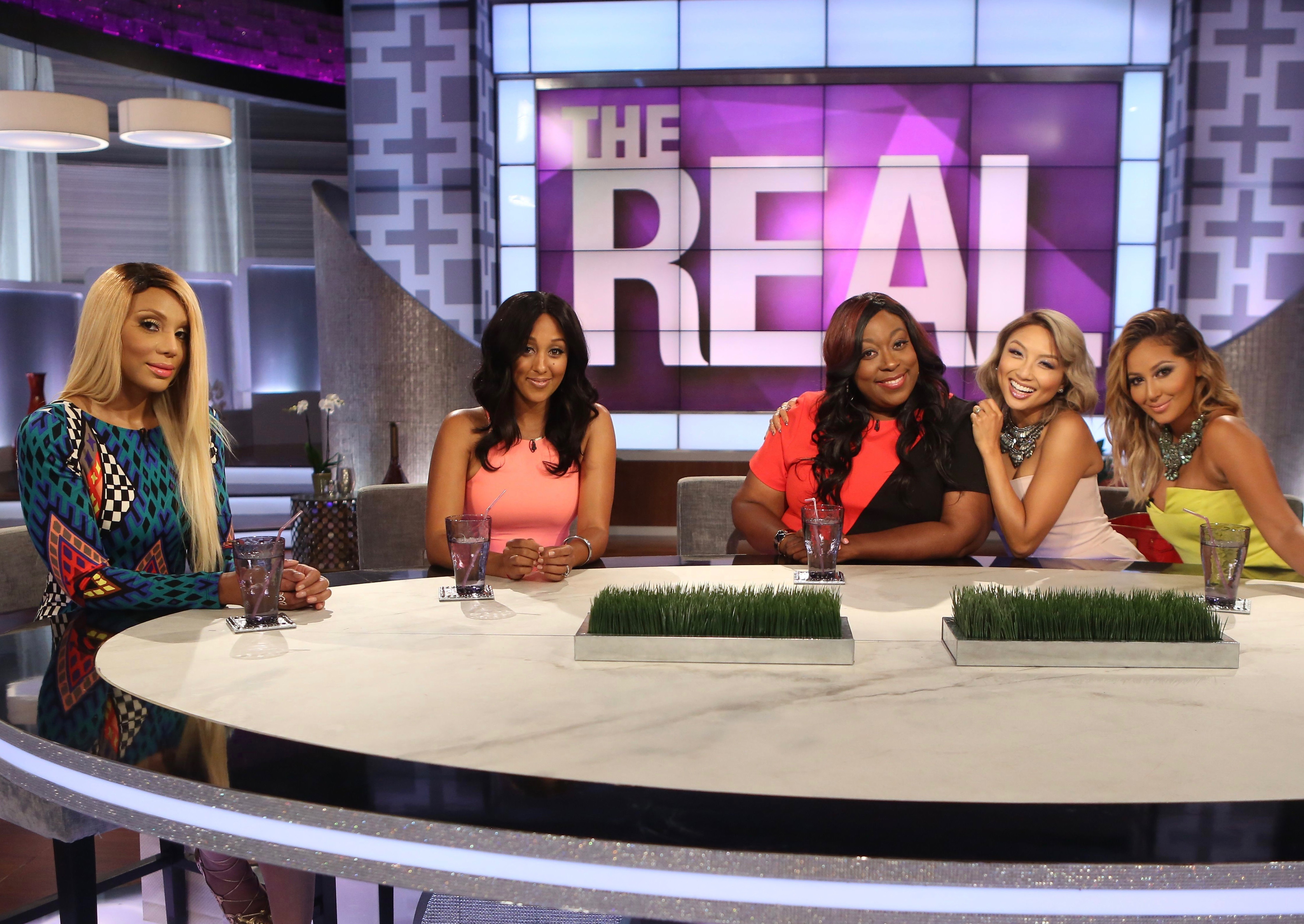 "This photo released by Warner Bros. shows, from left, Tamar Braxton, Tamera Mowry-Housley, Loni Love, Jeannie Mai, and Adrienne Bailon during the premiere episode of the new TV show, ""The Real."" The Warner Bros. show premieres on Monday, Sept. 15, 2014. (AP Photo/Warner Bros., Patrick Wymore)"