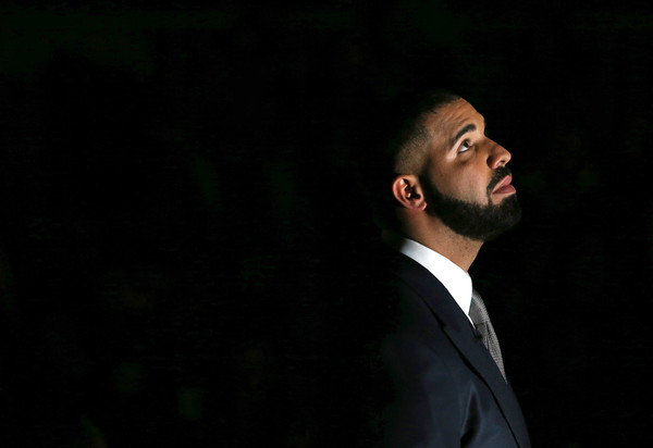 Head Coach Drake of Team Canada looks on from the bench during player introductions prior to the NBA All-Star Celebrity Game against Team USA at the Ricoh Coliseum on February 12, 2016 in Toronto, Ontario, Canada.