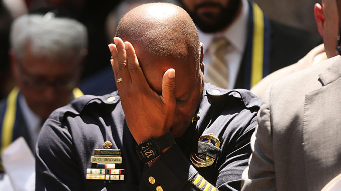 Dallas Police Chief David Brown pauses at a prayer vigil held July 8, following the deaths of five police officers the night before