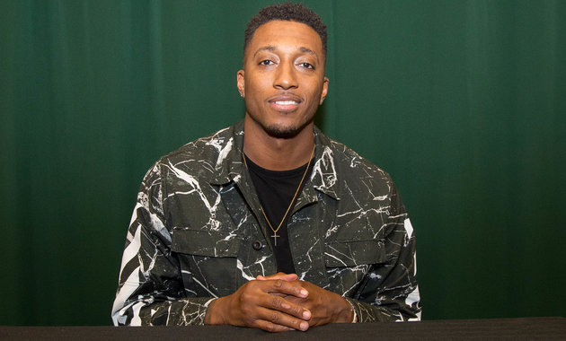 """NEW YORK, NY - MAY 03: Lecrae Moore signs copies of his new book """"Unashamed"""" at Barnes & Noble Tribeca on May 3, 2016 in New York City. (Photo by Adela Loconte/Getty Images)"""
