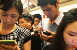 people fixated on smartphones