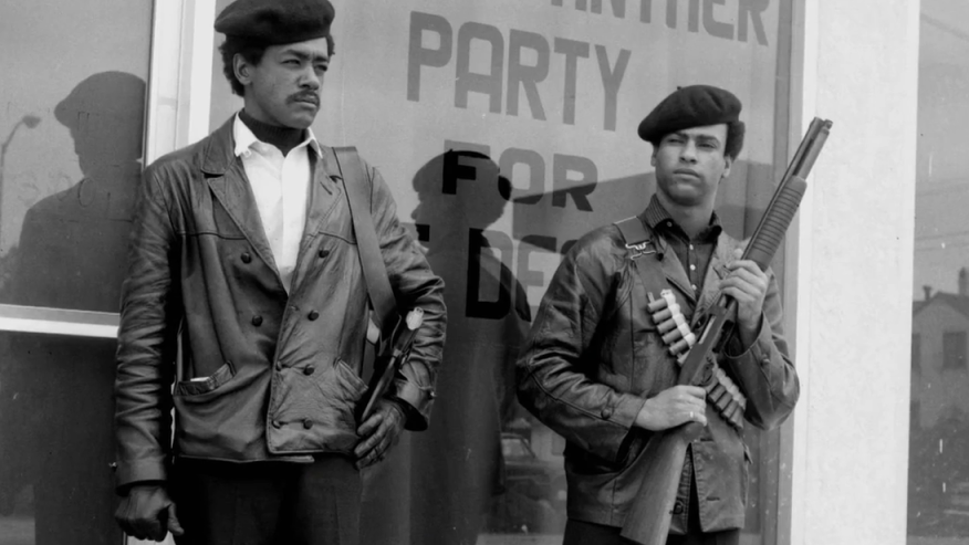 Bobby Seale (L) and Huey P. Newton