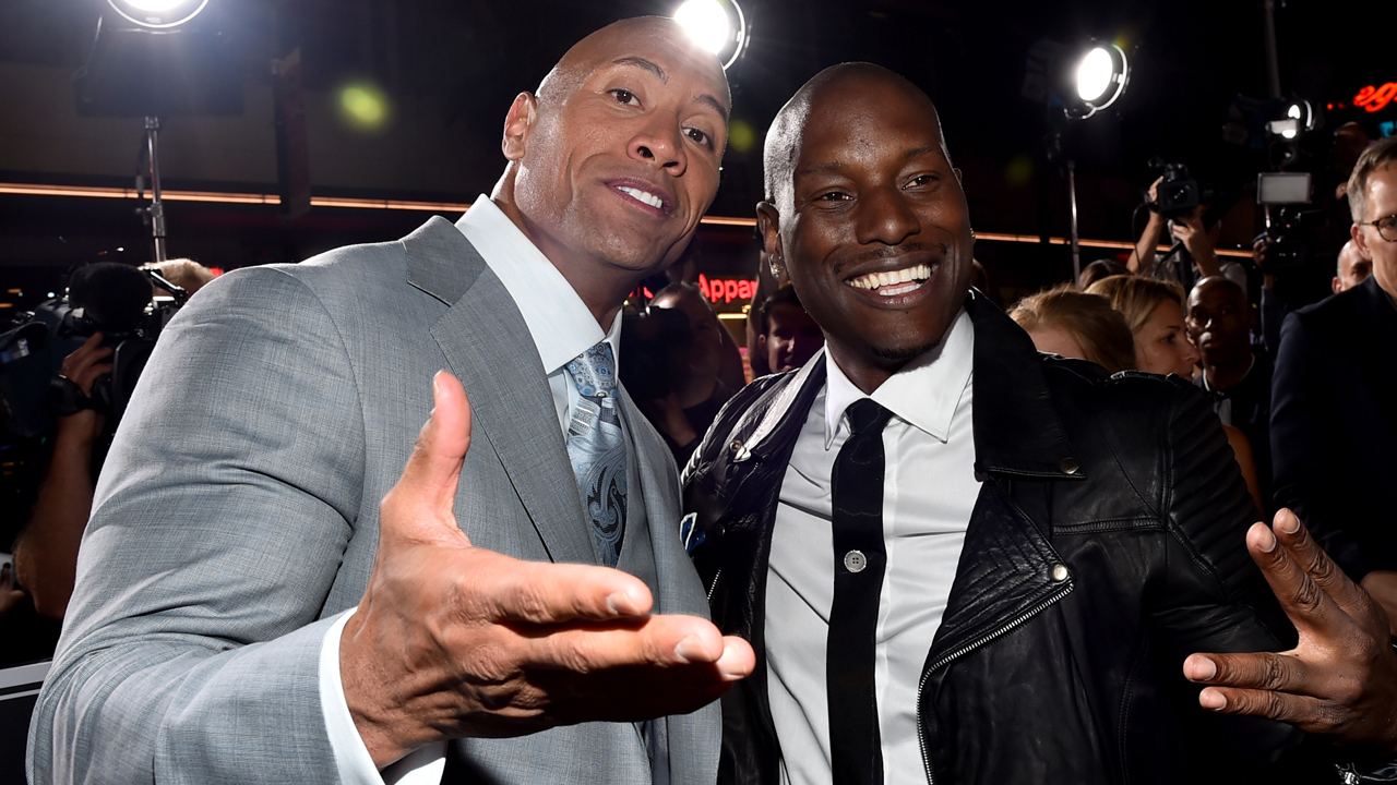 """Dwayne 'The Rock' Johnson (L) and recording artist/actor Tyrese Gibson attend Universal Pictures' """"Furious 7"""" premiere at TCL Chinese Theatre on April 1, 2015 in Hollywood, California.  (Photo by Alberto E. Rodriguez/Getty Images)"""