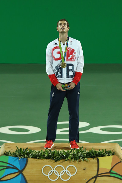 Gold medalist Andy Murray of Great Britain poses on the podium during the medal ceremony for the men's singles on Day 9 of the Rio 2016 Olympic Games at the Olympic Tennis Centre on August 14, 2016 in Rio de Janeiro, Brazil.