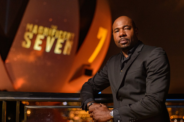 "Director Antoine Fuqua poses for a portrait during ""The Magnificent Seven"" red carpet and photo call at the ArtScience Museum at Marina Bay Sands on June 15, 2016 in Singapore."