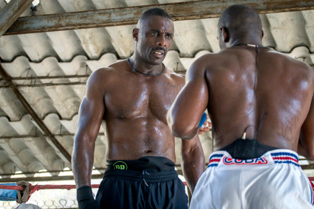 British actor Idris Elba, left, listens to Emilio Correa, a boxer with the Cuban National team at the Rafael Trejo boxing gym in the Old Havana section of Havana .  The session is part of the Discovery Network show Fighter. Elba is getting ready for his first kick boxing fight which will take place in October of this year.