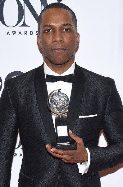 """Actor Leslie Odom Jr. poses in the press rom with his award for Best Performance by an Actor in a Leading Role in a Musical in """"Hamilton"""" at the 70th Annual Tony Awards at The Beacon Theatre on June 12, 2016 in New York City."""