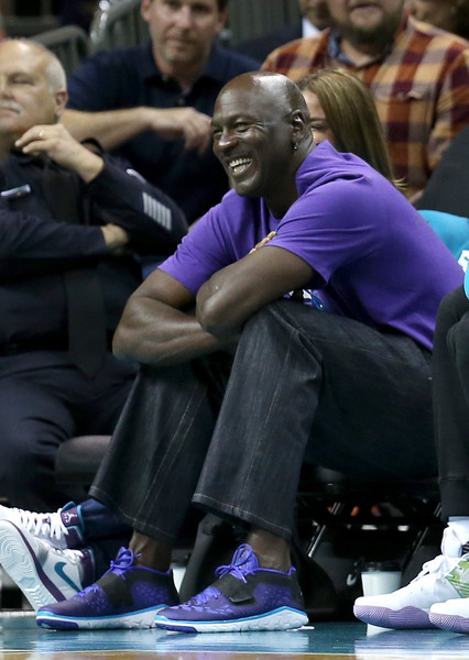 Owner of the Charlotte Hornets, Michael Jordan, watches on from the bench against the Miami Heat during game four of the Eastern Conference Quarterfinals of the 2016 NBA Playoffs at Time Warner Cable Arena on April 25, 2016 in Charlotte, North Carolina