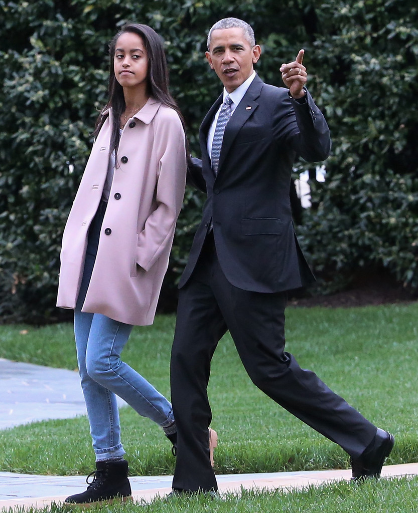 U.S. President Barack Obama walks with his daughter Malia toward Marine One while departing the White House April 7, 2016 in Washington, DC.